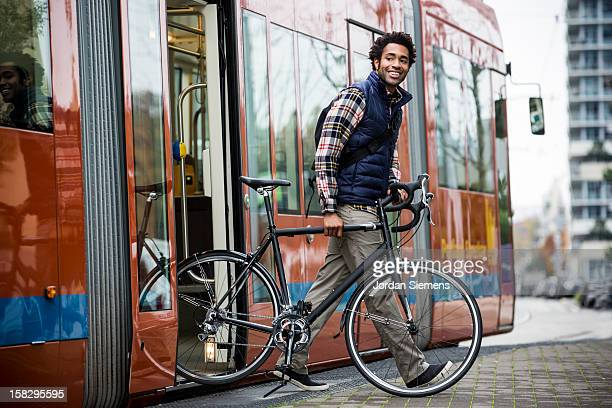 a man bike commuting. - tram stockfoto's en -beelden