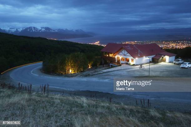 A man bikes at dusk on November 2 2017 in Ushuaia Argentina Ushuaia is situated along the southern edge of Tierra del Fuego in the Patagonia region...