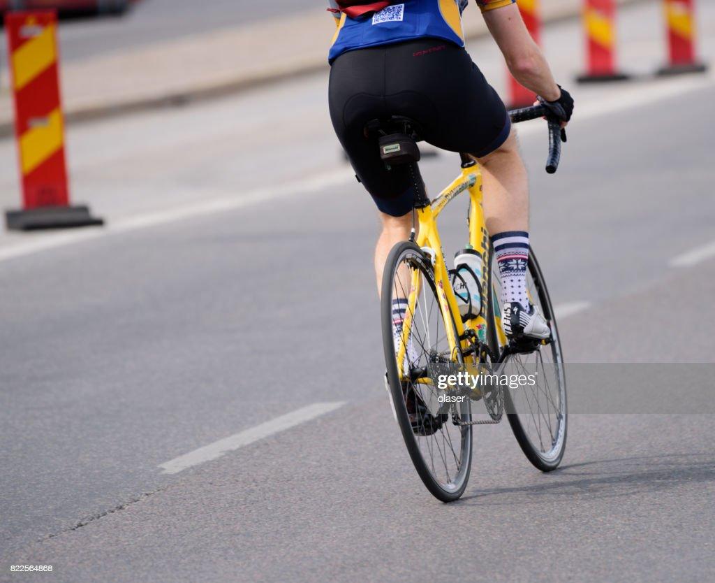 Man biking in traffic : Stock Photo