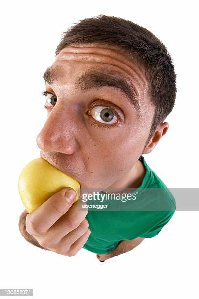 Man biting into an apple, fish-eye lens