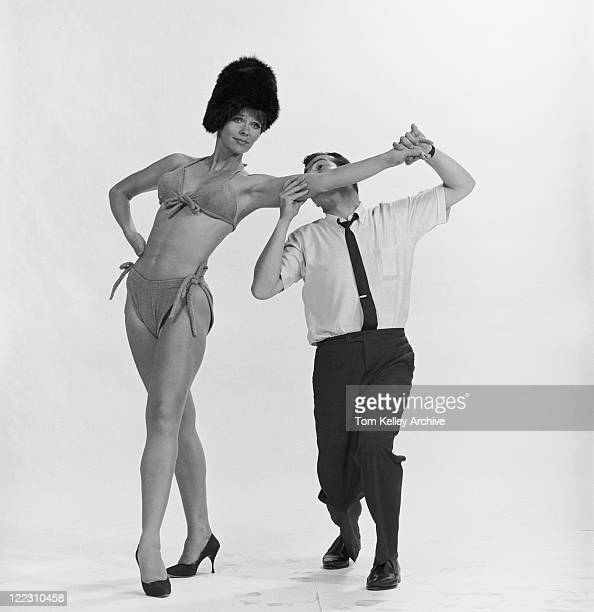 Man biting woman's arm