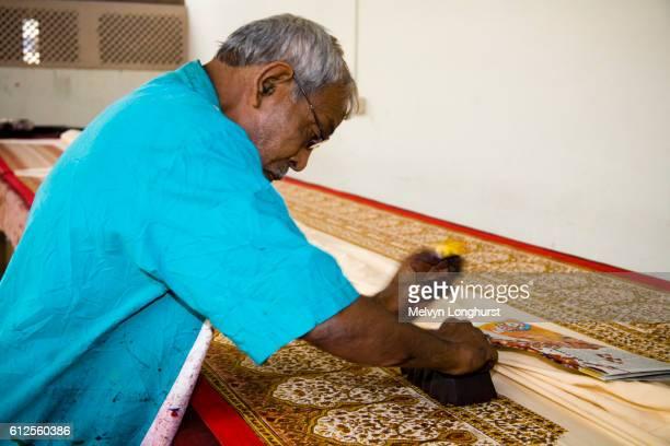Man block printing fabric by hand, Sanganer, near Jaipur, Rajasthan, India