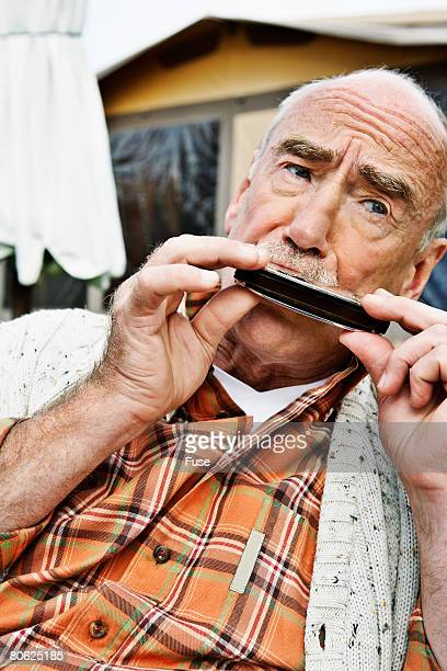 Man Blowing a Harmonica