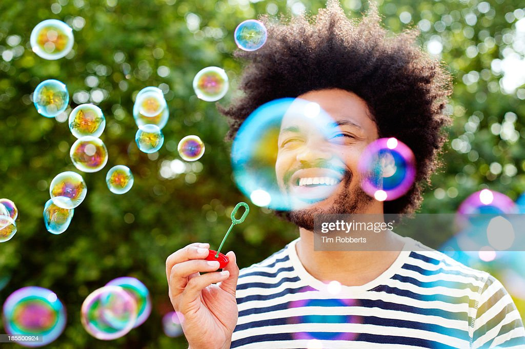Man blowing bubbles. : Stock Photo