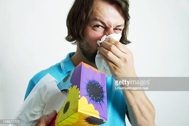 Man blowing his nose