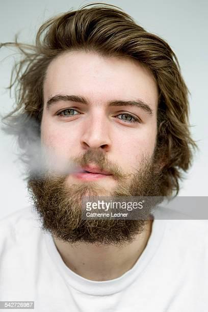 Man blowing out smoke