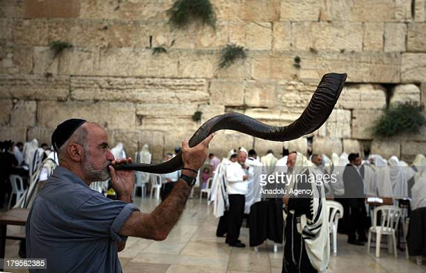 A man blowing the shofar a horn used for Jewish religious purposes on September 2 2013 in Jerusalem The Rosh Hashanah 2013 literally the head of the...