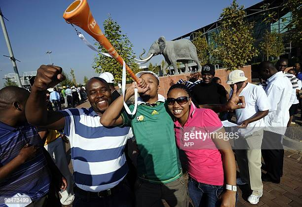A man blows a Vuvuzela as he queues along with others to purchase official 2010 FIFA World Cup tickets on April 15 2010 at the Maponya shopping mall...