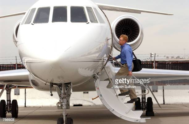 A man boards a private jet at ACM Aviation March 9 2002 in San Jose CA Since the September 11 2001 terrorist attacks many individuals have started to...