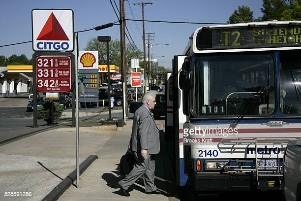 A man boards a public bus near gas stations in Bethesda Maryland outside Washington DC Area public transportation has experienced increased ridership...