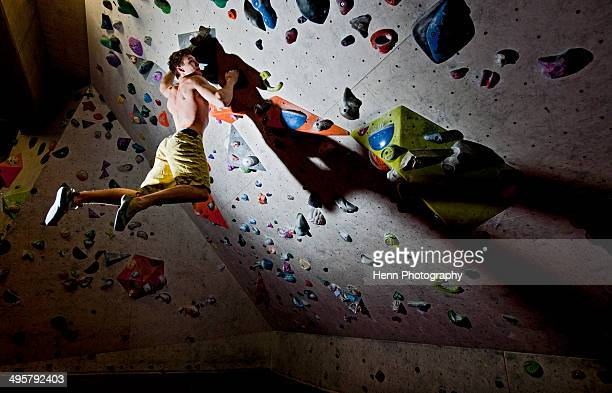 Man bouldering at indoor climbing centre