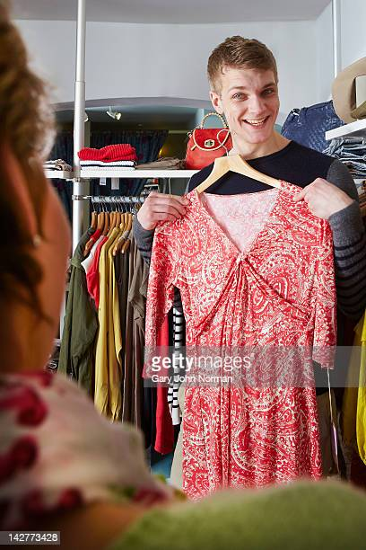 man boutique shopping - cocktail dress stock pictures, royalty-free photos & images
