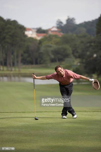 Man bowing on golf course