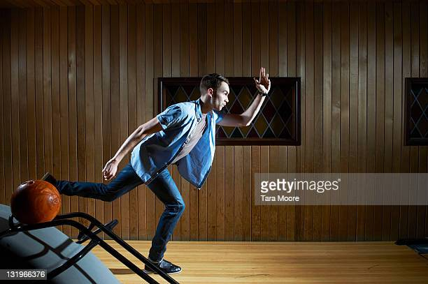 man bowling at alley - ボーリング場 ストックフォトと画像