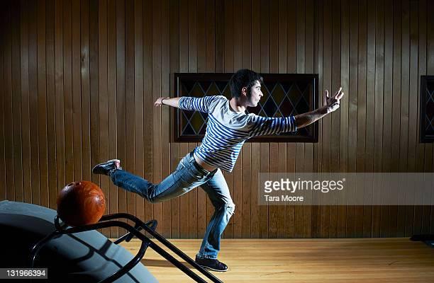 man bowling at bowling alley