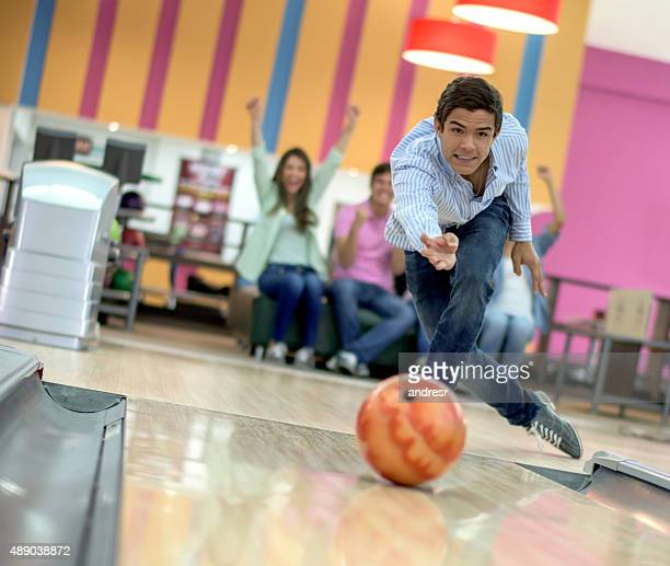 Man bowling with his friends