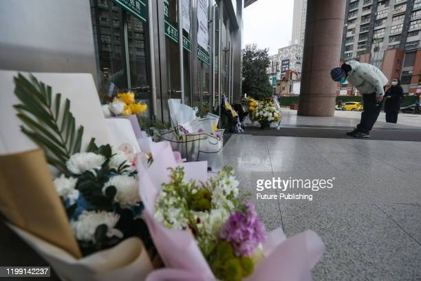 A man bows to pay tribute to Dr Li Wenliang at Li's hospital in Wuhan in central China's Hubei province Friday Feb 07 2020 Li regarded a...