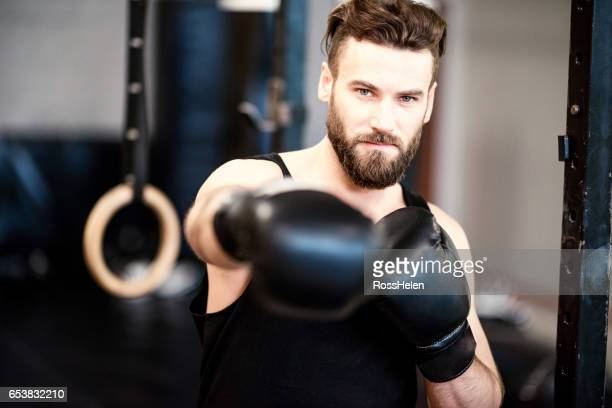 Man boxing at the gym