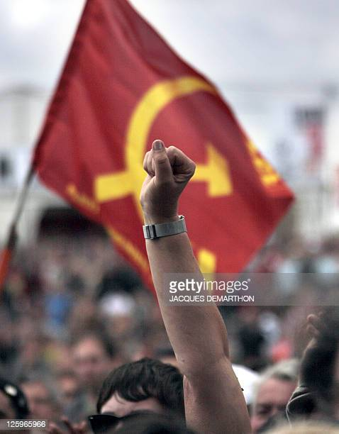 A man brandishes his fist as he listens to the final speech of the Fete de l'Humanité a political event organized by French communist party on...