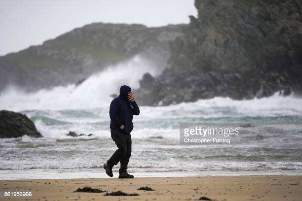 A man braves the winds of Hurricane Ophelia at Trearddur Bay on October 16 2017 in Holyhead Wales Hurricane Ophelia comes exactly 30 years after the...
