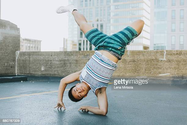 man breakdancing on concrete floor, boston, massachusetts, usa - breakdancing stock photos and pictures