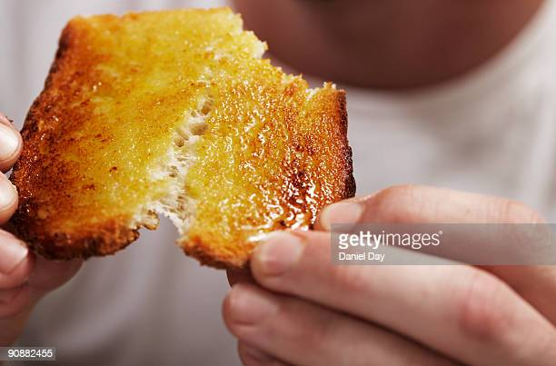man breaking bread  - butter stock pictures, royalty-free photos & images