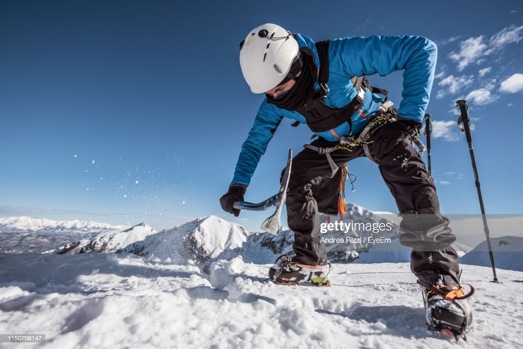 Man Breaking Snow Against Sky : Foto stock