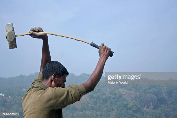 A man breaking stones at the bank of Dauki River in Jaflong Sylhet Bangladesh January 19 2010 The river coming from the Himalaya Mountains in India...
