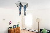 Man breaks ceiling drywall while doing DIY