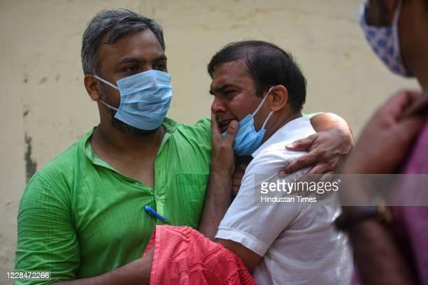 A man breaks down after paying tribute to the mortal remains of Social Activist Swami Agnivesh at Jantar Mantar on September 12 2020 in New Delhi...