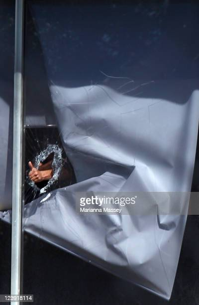 Man breaks through the glass in an office during a hostage situation in Parramatta on September 6, 2011 in Sydney, Australia. Reports a man has taken...