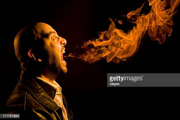 man breathing fire - heartburn, bad breath, or anger - dragon stock pictures, royalty-free photos & images