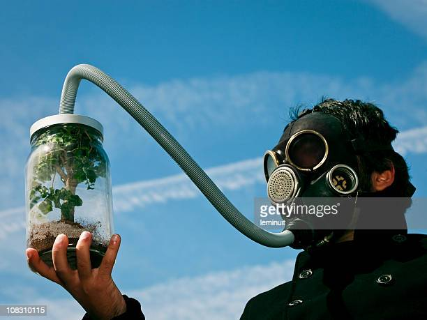 man breathing from the last tree of earth - photosynthesis stock photos and pictures