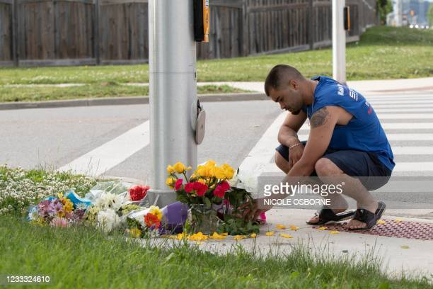 Man brings flowers and pays his respects at the scene where a man driving a pickup truck struck and killed four members of a Muslim family in London,...