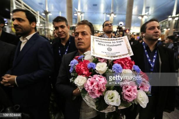 A man brings flowers as journalist Marzieh Hashemi arrives at Tehran Imam Khomeini International Airport in Tehran on January 30 2019 The USborn...