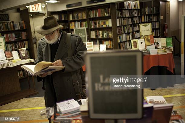 Man browses a book on love and romance at a Barnes & Noble Bookstore April 13, 2011 in New York.