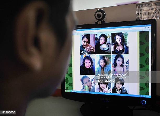 A man browses at pictures of Japanese porn star Maria Ozawa posted on a local website at a public Internet service in Jakarta on September 28 2009...