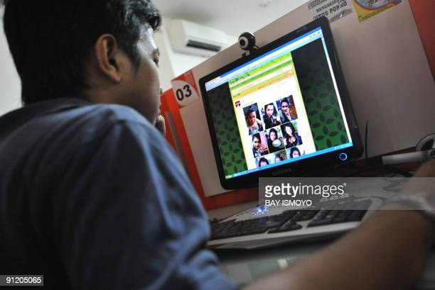 Man browses at pictures of Japanese porn star Maria Ozawa posted on a local website at a public Internet service in Jakarta on September 28, 2009....