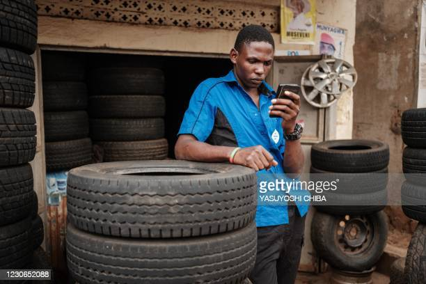 Man browses Facebook on his smart phone after the mobile internet went back online in Kampala, Uganda, on January 18, 2021.