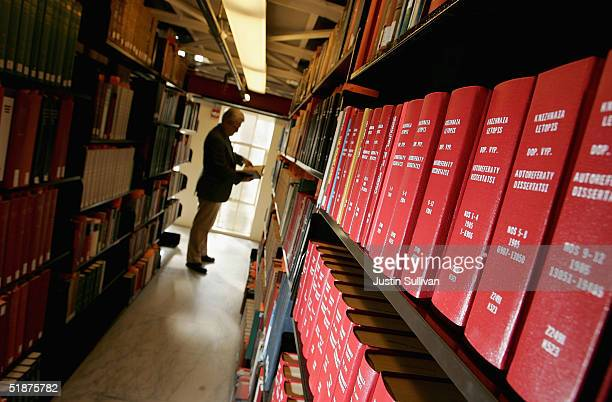 Man browses through books at the Cecil H. Green Library on the Stanford University Campus December 17, 2004 in Stanford, California. Google, the...