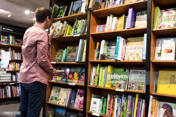 Man browsing in a Waterstones book shop.