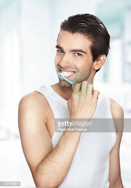 man brushing his teeth - newhealth stock pictures, royalty-free photos & images