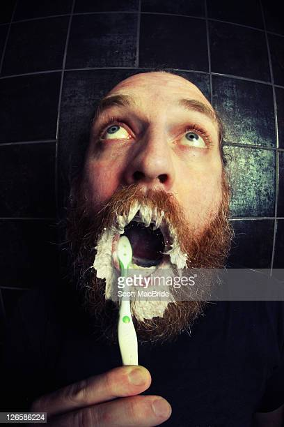 man brushing his teeth - scott macbride stock pictures, royalty-free photos & images