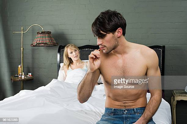 man brushing teeth in bedroom - flat chested woman stock photos and pictures