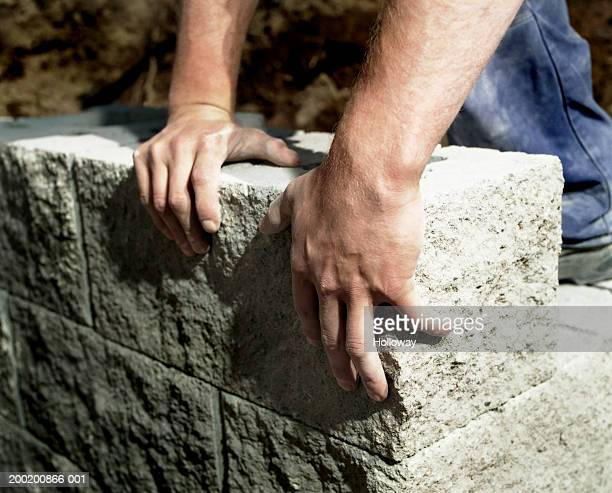 man building garden wall, close-up - wall building feature stock pictures, royalty-free photos & images