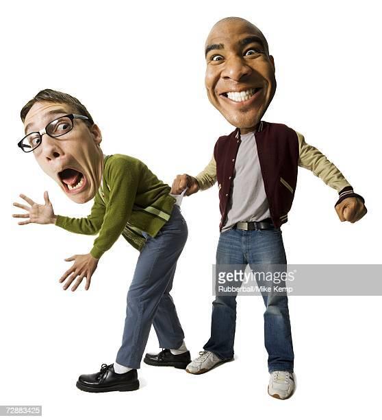 man bullying a nerd - interracial cartoon ストックフォトと画像
