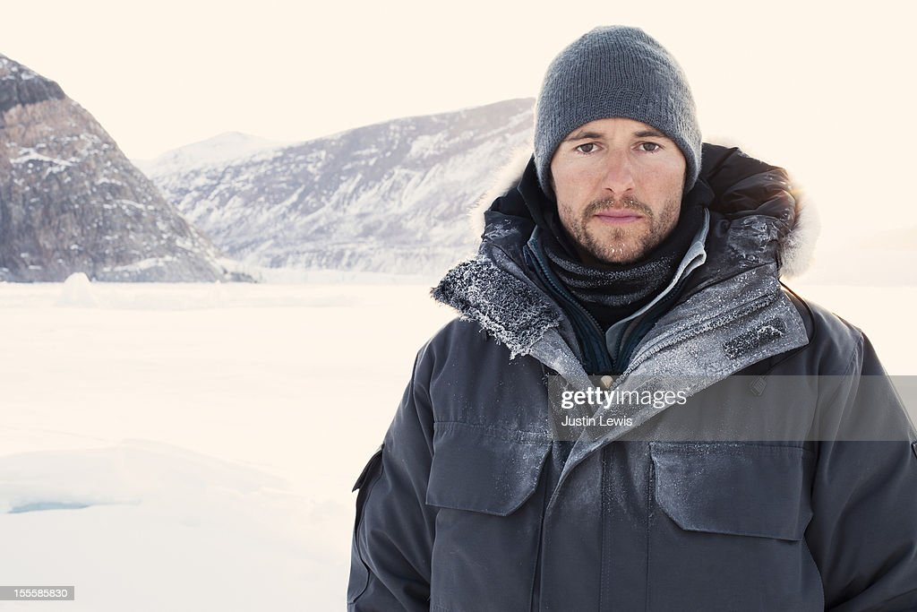 Man bundled with ice on jacket and sun shining : Stock Photo