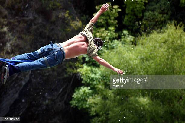 man bungee jumping in free fall