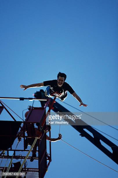 Man bungee jumping, view from below