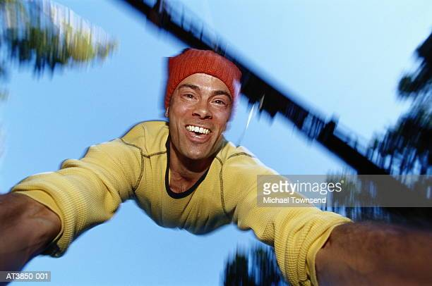 Man bungy jumping wearing knitted hat, self portrait, Canada